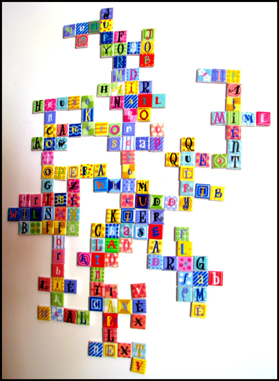 scrabble like arrangement of letters magnetized to refrigerator