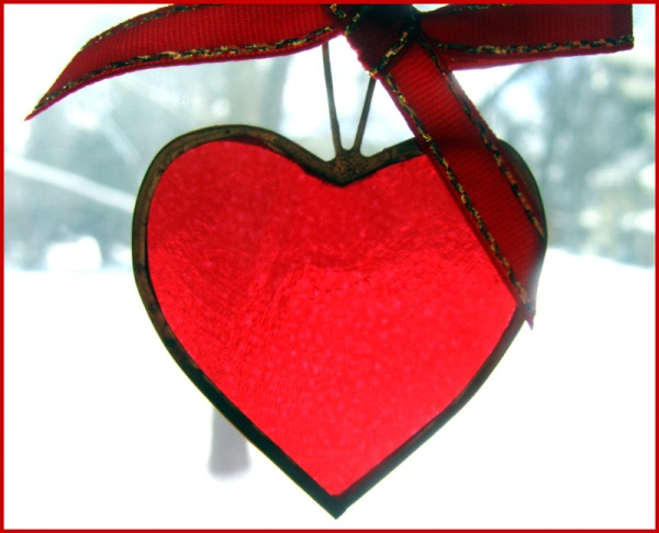 A transluscent red heart made from shell