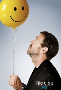 House (Hugh Laurie) stares balefully up at the happy face balloon he hold the string to.