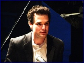 Michael Kaeshammer on stage seated at piano