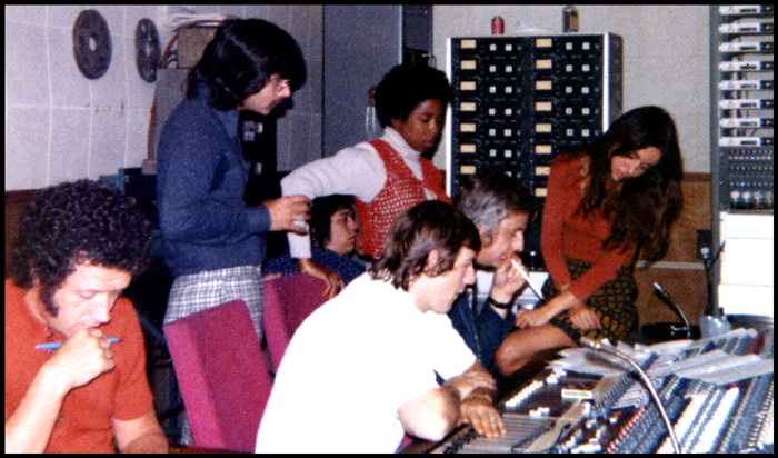 The singers squeezed into the control booth dominated by a massive mixing board, manned by sound technicians.