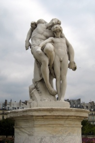 Statue - of a broken Spartacus being supported by a young man - standing in Paris