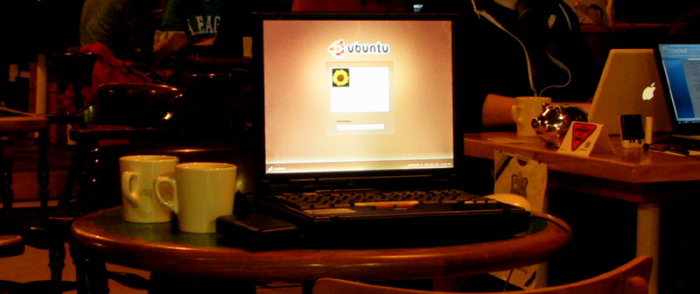 laptop open on cafe table, displaying the Ubuntu sign-in screen, Nanowrimo 2010