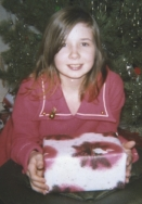 the author as a child with an unopened gift