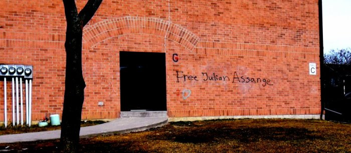 Graffiti on an apartment complex in Kitchener, Ontario, advocates freedom for Wikileaks founder Julian Assange