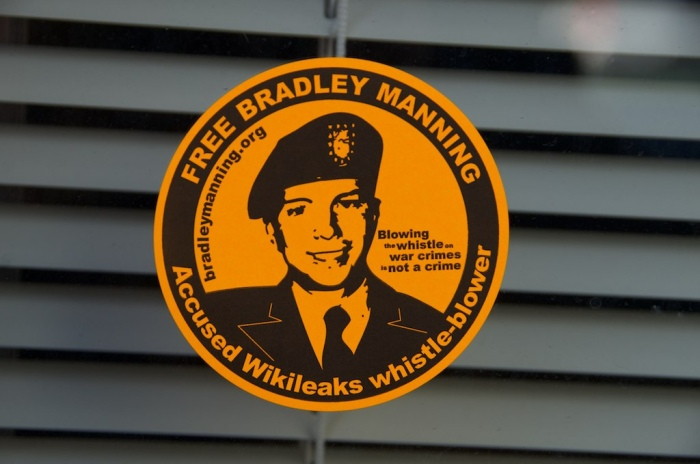 Free Bradley Manning Sticker affixed to a window backed with venetian blinds