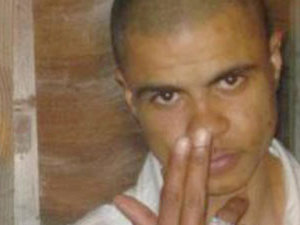 Mark Duggan holding two fingers to his nose, this is currently the most common photo of the slain young man online