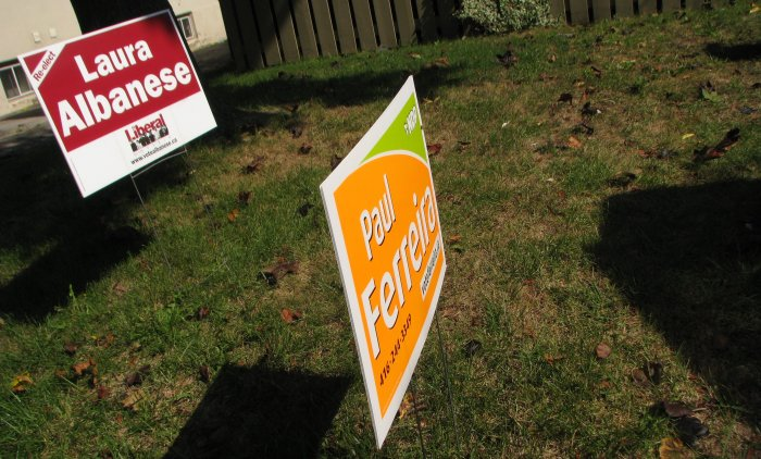 Liberal sign centered in the lawn overshadowing the NDP sign
