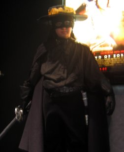 child in Zorro costume outside theatre