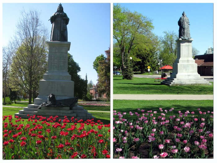 Red tulips planted in front of the statue, pink tulips behind
