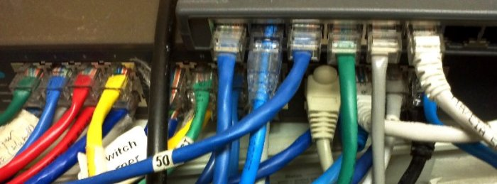 multicoloured Internet cables plugged into jacks