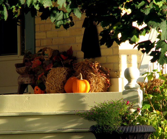 pumpkins on the porch in a decorative arrangement