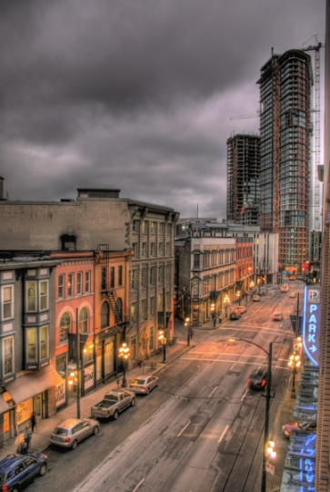 A high angle photo of Vancouver's Cordova Street under a glowering sky.