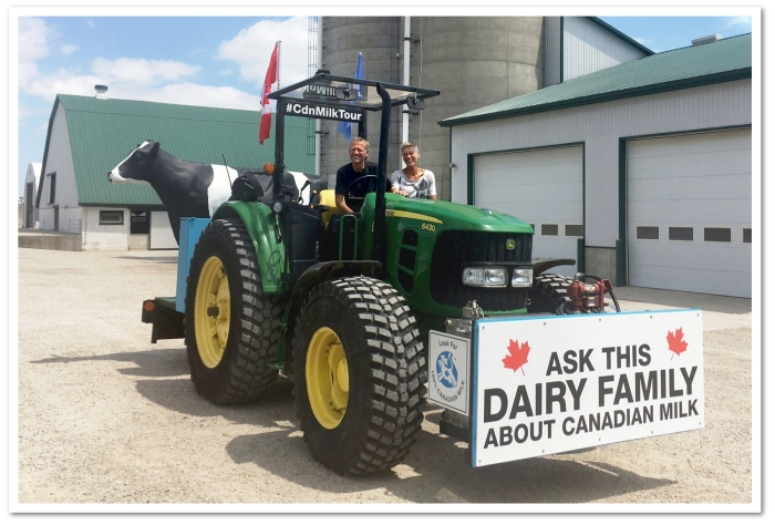 "Henk and Bettina Schuurmans on their ""Ask This Dairy Family about Canadian Milk"" John Deere 6430 Tractor."